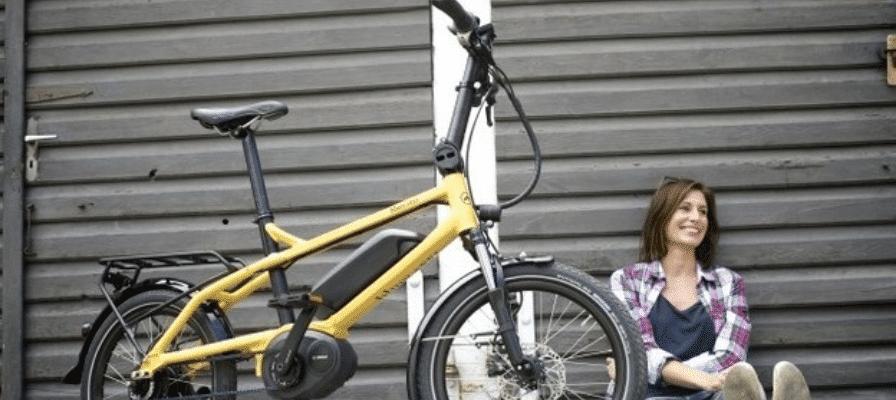 Frau mit gelbem e-Bike blueLABEL Pony